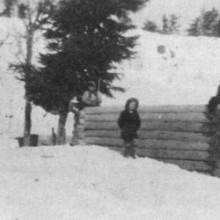 Betty and Janette building their cabin, with little sister Minerva standing in front