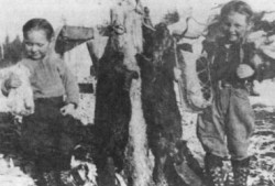 Janette and Betty with trapline catches circa 1930s